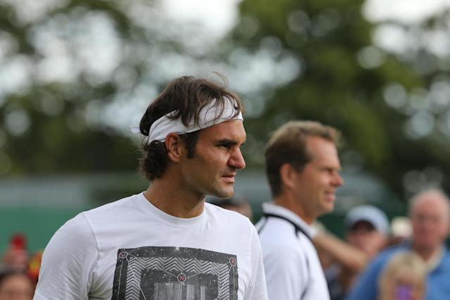 Switzerland's Roger Federer (L) is pictured during a training session with his coach Stefan Edberg on July 5, 2014 (AFP Photo/Andrew Cowie)