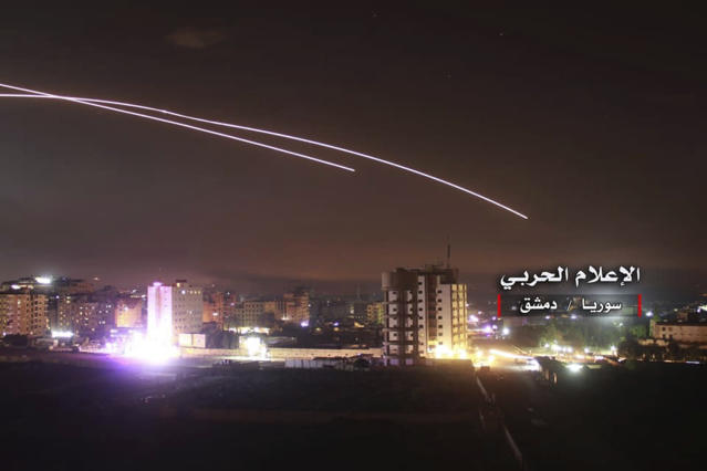 <p>This photo provided early Thursday, May 10, 2018, by the government-controlled Syrian Central Military Media, shows missiles rise into the sky as Israeli missiles hit air defense position and other military bases, in Damascus, Syria. (Photo: Syrian Central Military Media, via AP) </p>