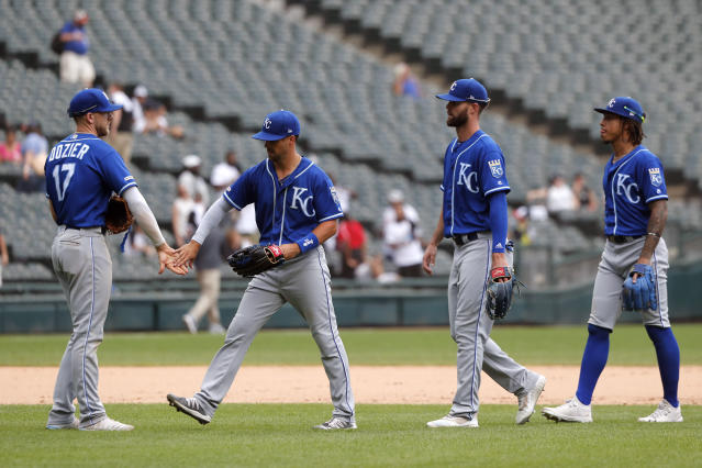 Kansas City Royals' Hunter Dozier (17) celebrate with teammates the team's win over the Chicago White Sox after a baseball game Thursday, Sept. 12, 2019, in Chicago. (AP Photo/Charles Rex Arbogast)