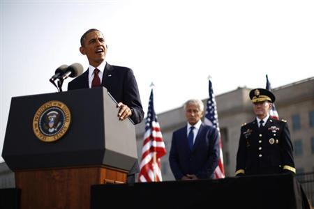 U.S. President Barack Obama speaks alongside Secretary of Defense Chuck Hagel (C) and Chairman of the Joint Chiefs of Staff Martin Dempsey (R) as they participate in an event on the 12th anniversary of the 9/11 attacks at the Pentagon near Washington, September 11, 2013. REUTERS/Jason Reed