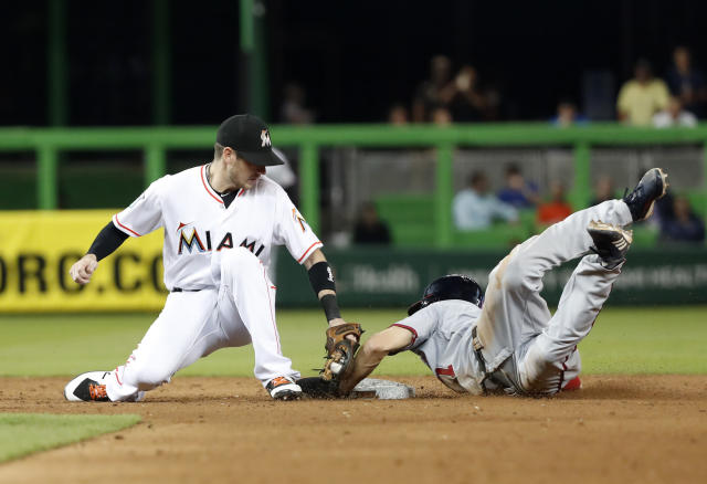 Washington Nationals' Trea Turner, right, steals second base as Miami Marlins shortstop JT Riddle attempts the tag during the sixth inning of a baseball game, Tuesday, Sept. 18, 2018, in Miami. (AP Photo/Wilfredo Lee)