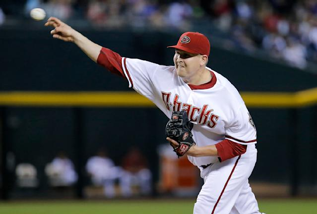 Arizona Diamondbacks pitcher Trevor Cahill throws against the Chicago Cubs during the first inning of a baseball game, Friday, July 18, 2014, in Phoenix. (AP Photo/Matt York)