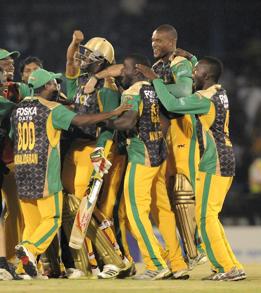 PORT OF SPAIN, TRINIDAD AND TOBAGO - AUGUST 24:   Jamaica Tallawahs celebrating victory against Guyana Amazon Warriors during the Final of the Caribbean Premier League between Guyana Amazon Warriors v Jamaica Tallawahs at Queens Park Oval on August 24, 2013 in Port of Spain, Trinidad and Tobago. (Photo by Randy Brooks/Getty Images Latin America for CPL)