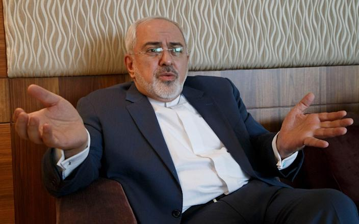 Iranian Foreign Minister Mohammad Javad Zarif gestures as he speaks during an interview - AP Photo/Michel Euler