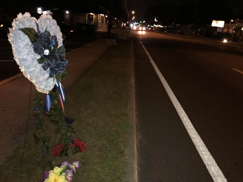 A memorial wreath for one of the four victims whom a 24-year-old man allegedly shot dead over a period of weeks in Tampa, Florida (AFP Photo/Les Neuhaus)