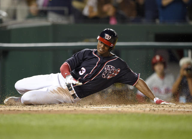 Washington Nationals outfielder Michael Taylor slides home on his inside-the-park-grand slam against the Phillies. (AP)