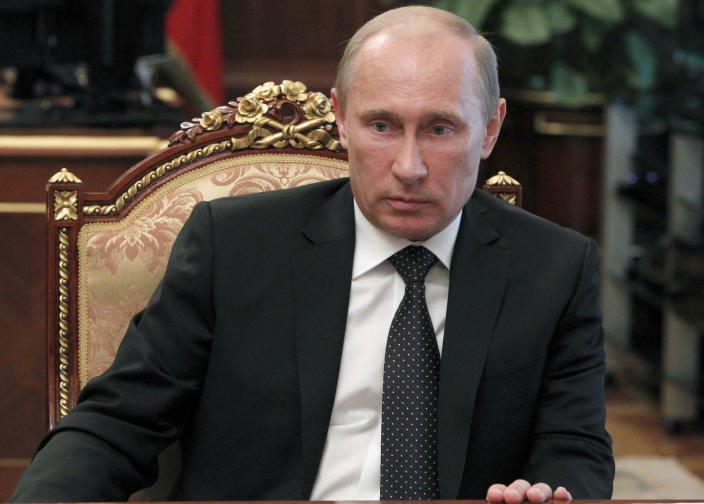 Russian President Vladimir Putin, background, heads a meeting to discuss flooding in southern Russia in Moscow on Monday, July 9, 2012. Authorities failed to properly warn residents in the Black Sea region of floods that killed at least 171 people and left others scrambling for safety, Russia's emergencies minister acknowledged Monday, adding to outrage over the handling of the disaster fueled by widespread mistrust of the government. (AP Photo/RIA Novosti Kremlin, Mikhail Klimentyev, Presidential Press Service)