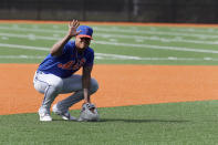 New York Mets' Marcus Stroman waves to fans during spring training baseball practice Saturday, Feb. 15, 2020, in Port St. Lucie, Fla. (AP Photo/Jeff Roberson)