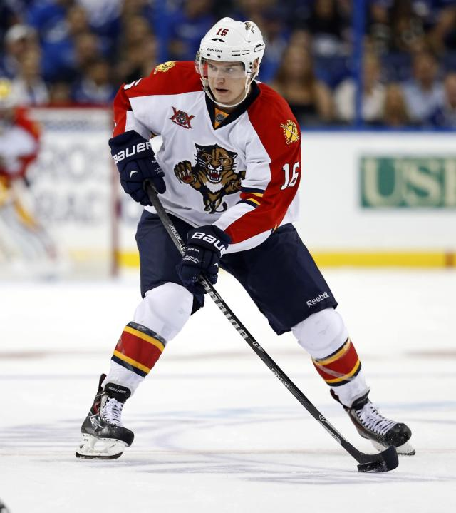 TAMPA, FL - OCTOBER 10: Aleksander Barkov #16 of the Florida Panthers takes the puck up the ice against the Tampa Bay Lightning at the Tampa Bay Times Forum on October 10, 2013 in Tampa, Florida. (Photo by Mike Carlson/Getty Images)