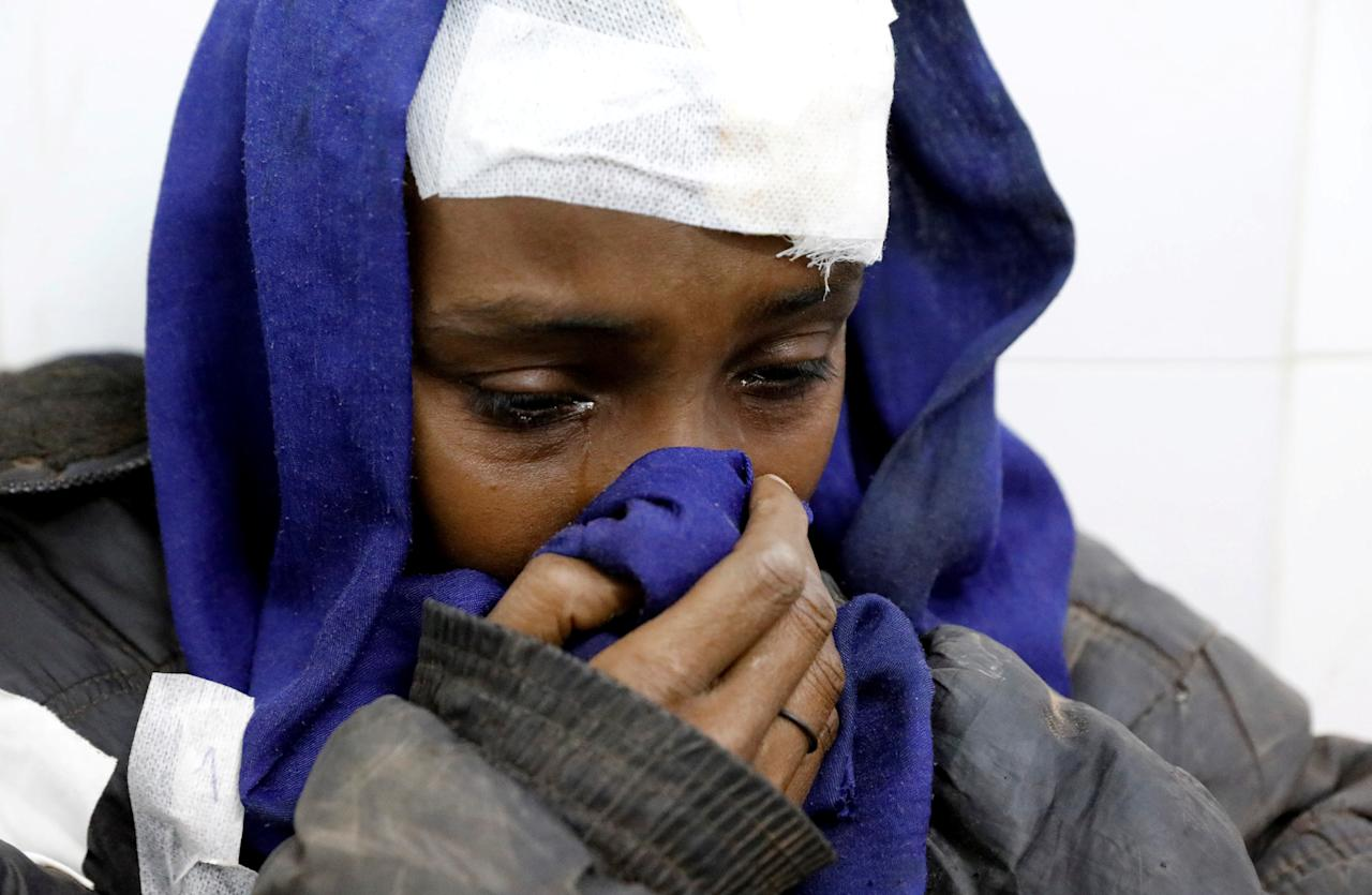 A migrant who was injured in a truck crash reacts at a hospital in Bani Walid town, Libya, February 14, 2018. REUTERS/Hani Amara     TPX IMAGES OF THE DAY