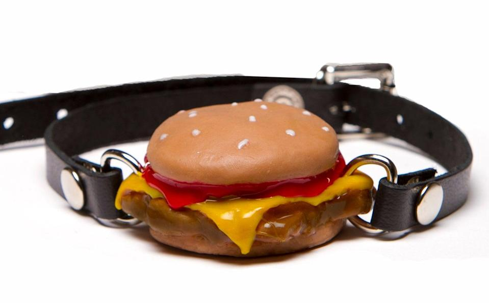 """If you love a good cheeseburger, there's a ball gag just for you. Instead of taking a bite into a standard 'ole ball, sink your teeth into a (food-grade silicone) burger. The visual is amazing, and the product is super high-quality at that. One Etsy reviewer wrote, """"How could it be adorable and so kinky at the same time? It's well made and small enough for the beginner. Ships in its own paper burger tray."""" $200, Etsy. <a href=""""https://www.etsy.com/listing/214892623/silencing-slider-cheeseburger-ball-gag"""" rel=""""nofollow noopener"""" target=""""_blank"""" data-ylk=""""slk:Get it now!"""" class=""""link rapid-noclick-resp"""">Get it now!</a>"""