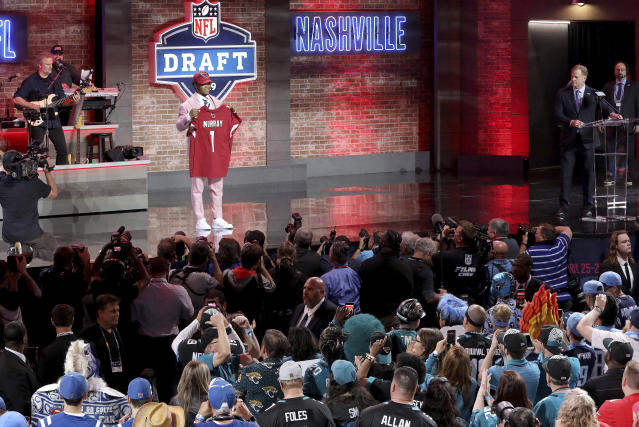 Oklahoma quarterback Kyler Murray shows off his new jersey after the Arizona Cardinals selected Murray in the first round at the NFL football draft, Thursday, April 25, 2019, in Nashville, Tenn. (AP Photo/Gregory Payan)