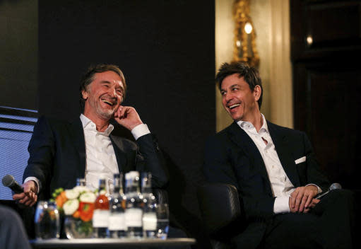 Toto Wolff, Team Principal & CEO of The Mercedes AMG-PETRONAS F1 Team, right, and INEOS Founder and Chairman Jim Ratcliffe attend a media briefing in London, Monday, Feb. 10, 2020. The Mercedes Formula One team is still waiting to secure a long-term commitment from world champion Lewis Hamilton. Wolff says he hasn't spoken to Hamilton since the Christmas party after agreeing to leave each other in peace in the offseason. Mercedes has longer certainty from its new sponsor INEOS, the chemicals giant owned by Jim Ratcliffe. (Steven Paston/PA via AP)