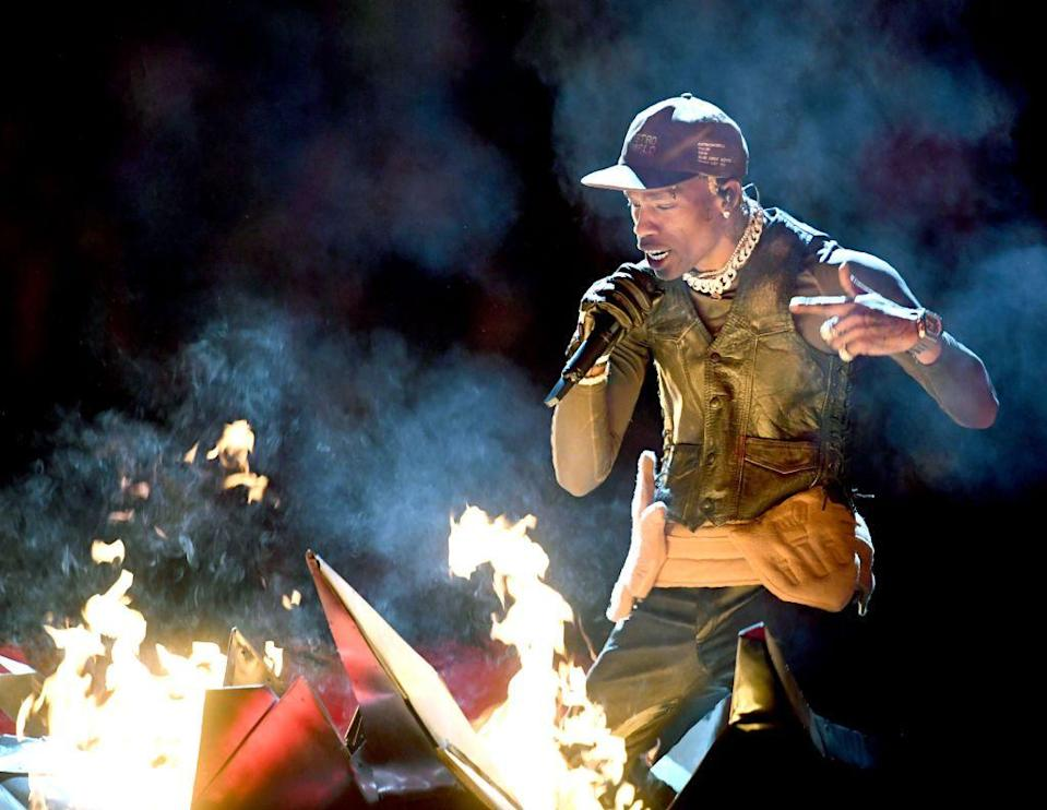 <p>Rapper Travis Scott wore a leather waistcoat, cap and leather trousers. </p>