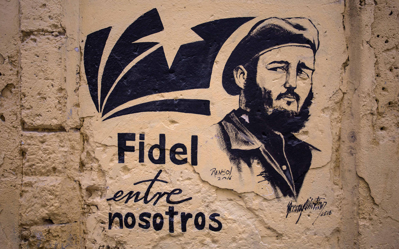 "<p>A stencil graffiti featuring Fidel Castro's image says in Spanish ""Fidel among us,"" in an alleyway in Havana, Cuba, Sunday, Nov. 27, 2016. (AP Photo/Desmond Boylan) </p>"