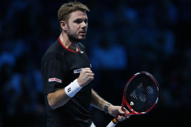 Stanislas Wawrinka of Switzerland pumps his fist after winning a point against Tomas Berdych of Czech Republic during their ATP World Tour Finals single tennis match at the O2 Arena in London Monday, Nov. 4, 2013. (AP Photo/Sang Tan)