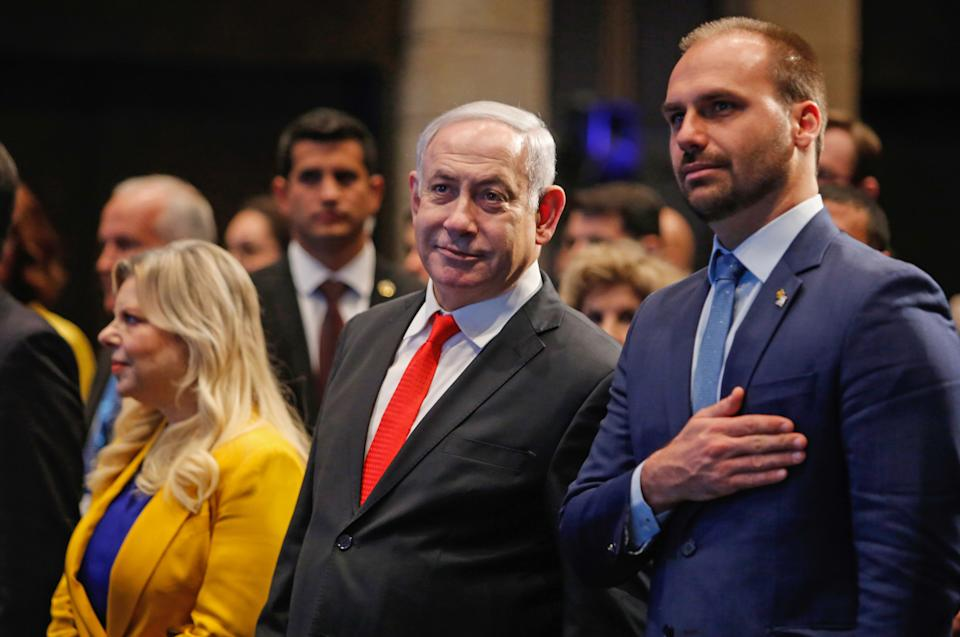 Israeli Prime Minister Benjamin Netanyahu attend with his wife Sara and Brazilian Federal Deputy Eduardo Bolsonaro (R) the opening ceremony of the Brazilian Ministry Trade And Investment Promotion Agency in Jerusalem on December 15, 2019. (Photo by Gil COHEN-MAGEN / AFP) (Photo by GIL COHEN-MAGEN/AFP via Getty Images)