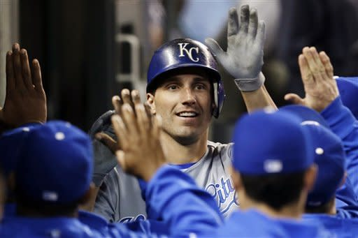 Kansas City Royals' Jeff Francoeur celebrates his solo home run against the Detroit Tigers in the fourth inning of a baseball game in Detroit, Wednesday, Sept. 26, 2012. (AP Photo/Paul Sancya)