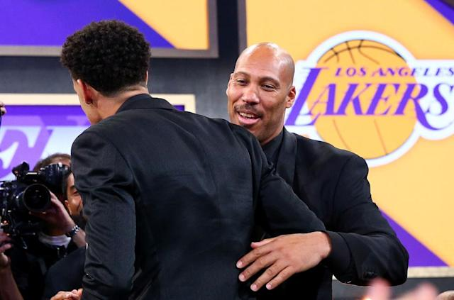 LaVar Ball (right) congratulates his son Lonzo after he was selected second in the NBA draft by the Lakers. (Getty)