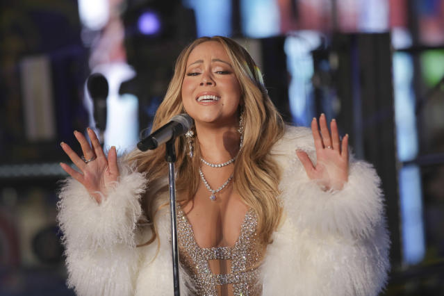 <p>Mariah Carey performs on stage at the New Year's Eve celebration in Times Square on Sunday, Dec. 31, 2017, in New York. (Photo: Brent N. Clarke/Invision/AP) </p>