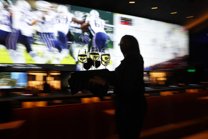 A handful of states now offer legal sports betting in casinos or online. (AP Photo/Paul Sancya)