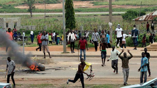 PHOTO: Protesters throw rocks at policemen during an attack on South African business, in Abuja, Nigeria, Sept. 4, 2019. (AP)