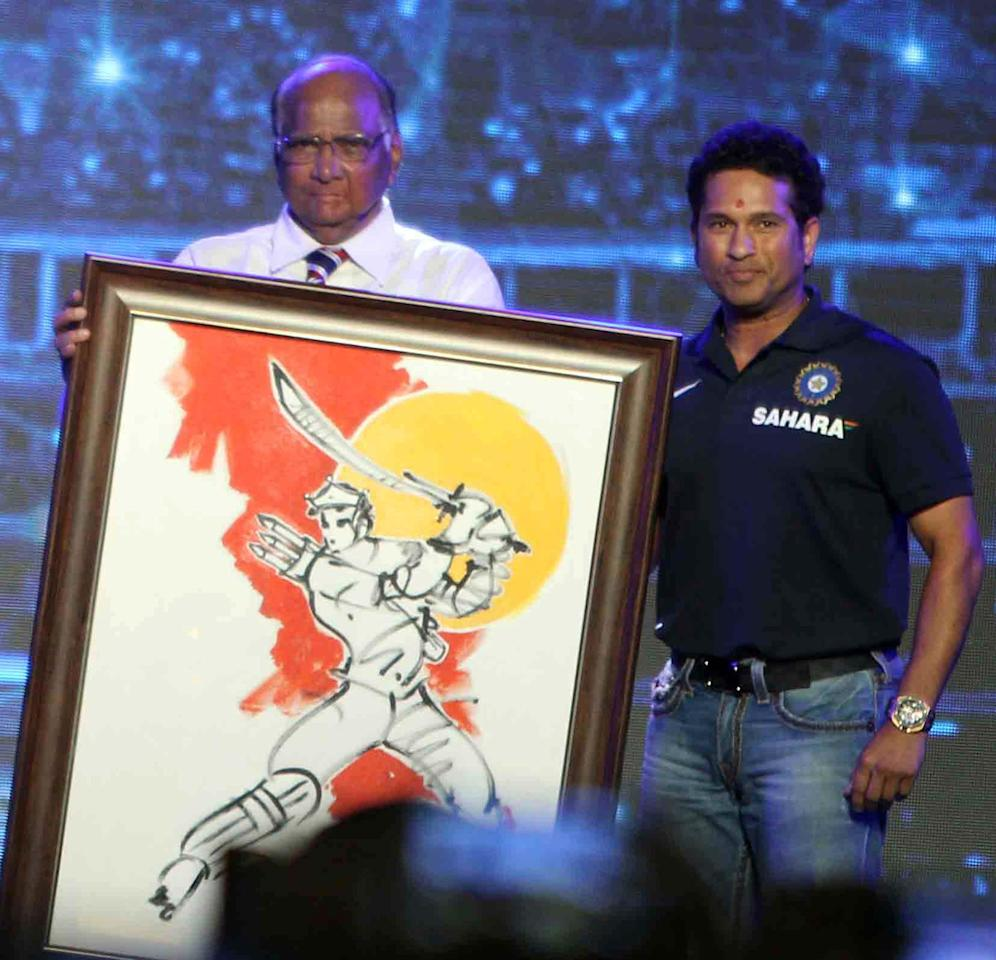 Union Agriculture Minister and MCA (Mumbai Cricket Association) president Sharad Pawar felicitatesIndian cricketer Sachin Tendulkar during the rechristening ceremony of MCA sport complex at Kandivali West Mahavir Nagar as `Sachin Tendulkar Gymkhana` in Mumbai on Nov.11, 2013. (Photo: Sandeep Mahankaal/IANS)