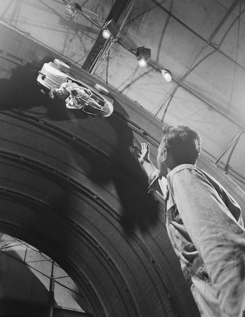 <p>Spectators could watch from down below — perhaps a bit too closely — at Riverview Park in Chicago. The attraction shut down in the mid-'60s due to safety concerns, and Riverview closed entirely in 1967.</p>