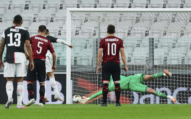 Juventus' Cristiano Ronaldo hits the post on a penalty kick as AC Milan goalie Gianluigi Donnarumma dives, during an Italian Cup second leg soccer match between Juventus and AC Milan at the Allianz stadium, in Turin, Italy, Friday, June 12, 2020. The match was being played without spectators because of the coronavirus lockdown. (Spada/LaPresse via AP)