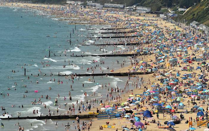 Thousands descended on to Bournemouth beach - AFP