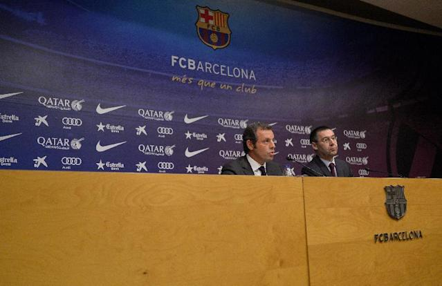 FC Barcelona's President Sandro Rosell, left, and Vice-president Josep Maria Bartomeu, attend a press conference at the Camp Nou stadium in Barcelona, Spain, Thursday, Jan 23, 2014. Sandro Rosell is stepping down as president of Barcelona a day after a judge agreed to hear a lawsuit accusing him of allegedly hiding the cost of the transfer of Brazil striker Neymar. Rosell says he is resigning after an emergency meeting with Barcelona's board of directors on Thursday. Rosell says vice president Josep Bartomeu will take his place as president and finish the term that expires in 2016. Elected in 2010 to replace outgoing president Joan Laporta, Rosell said last April he planned to run for re-election in 2016. (AP Photo/Manu Fernandez)