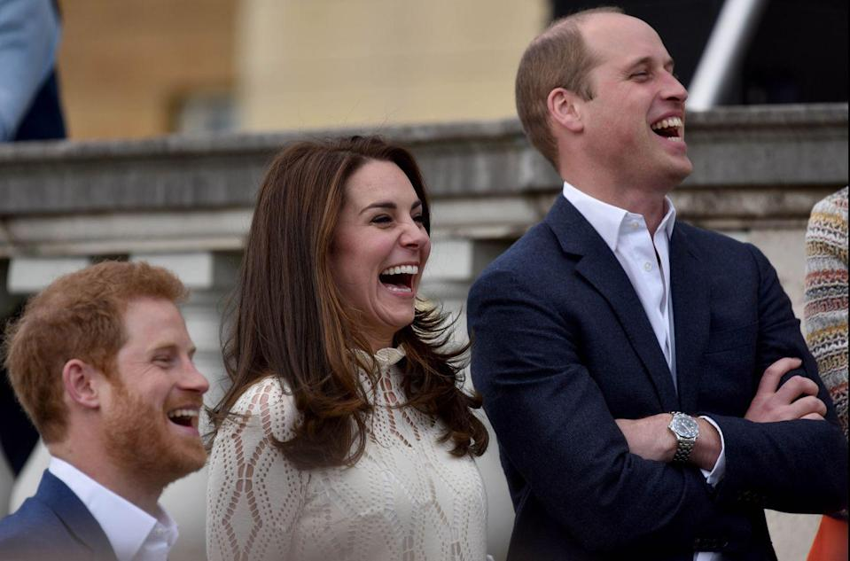 <p>It's no secret that Buckingham Palace is the perfect place for a tea party (complete with crumpets), but it appears this event for children wasn't <em>all</em> prim and proper. William, Kate, and Harry look so joyful in this photo, you can almost hear them laughing. <br></p>