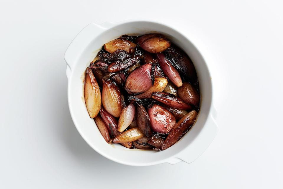 "This recipe would also work with small cipolline onions or larger torpedo-shaped shallots. <a href=""https://www.bonappetit.com/recipe/cider-and-bourbon-glazed-shallots?mbid=synd_yahoo_rss"" rel=""nofollow noopener"" target=""_blank"" data-ylk=""slk:See recipe."" class=""link rapid-noclick-resp"">See recipe.</a>"