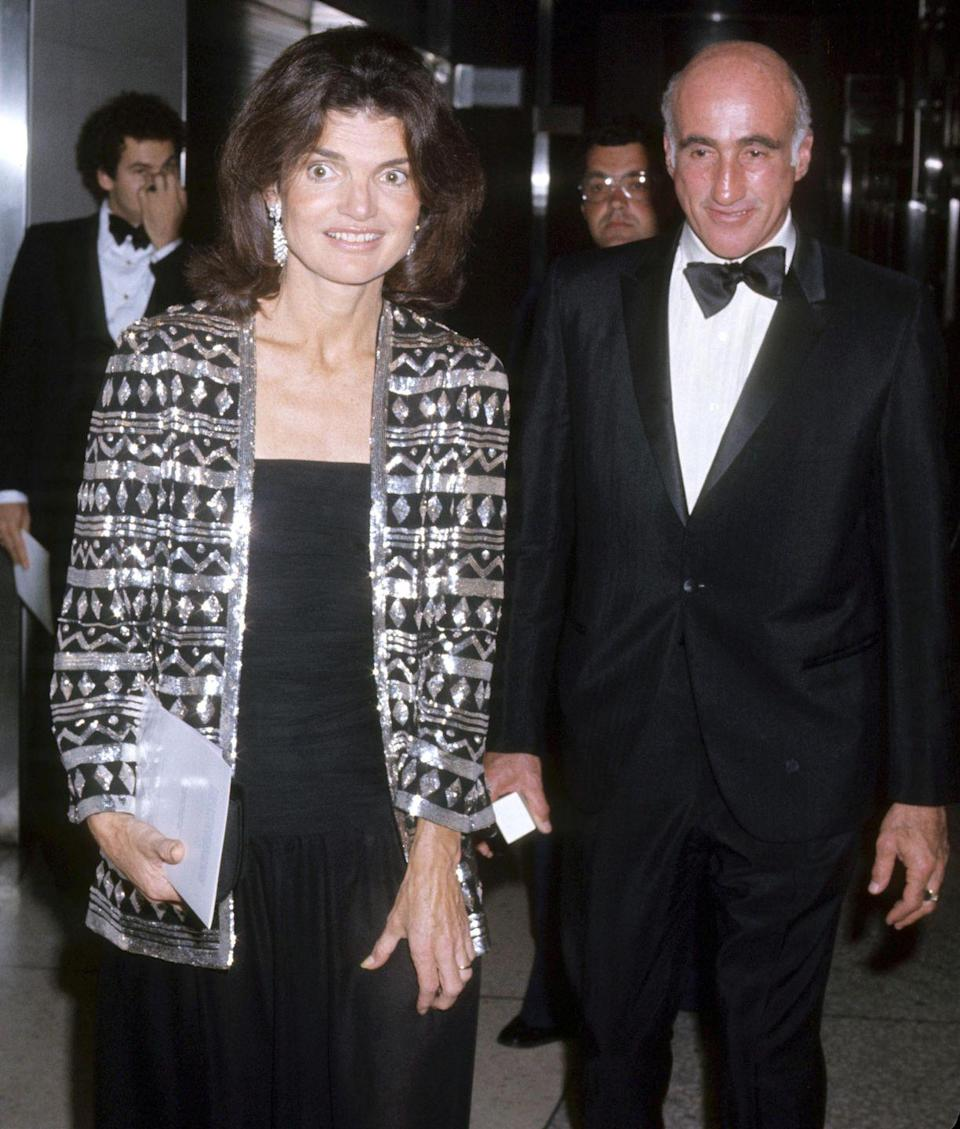 <p>Jackie Onassis arrives for an event with Tom Guinzburg for whom she worked as an editor at Viking Press.</p>