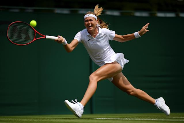 Marie Bouzkova of Czech Republic plays a forehand during the Ladies' Singles first round match against Mona Barthel of Germany during Day one of The Championships - Wimbledon 2019 at All England Lawn Tennis and Croquet Club on July 01, 2019 in London, England. (Photo by Matthias Hangst/Getty Images)