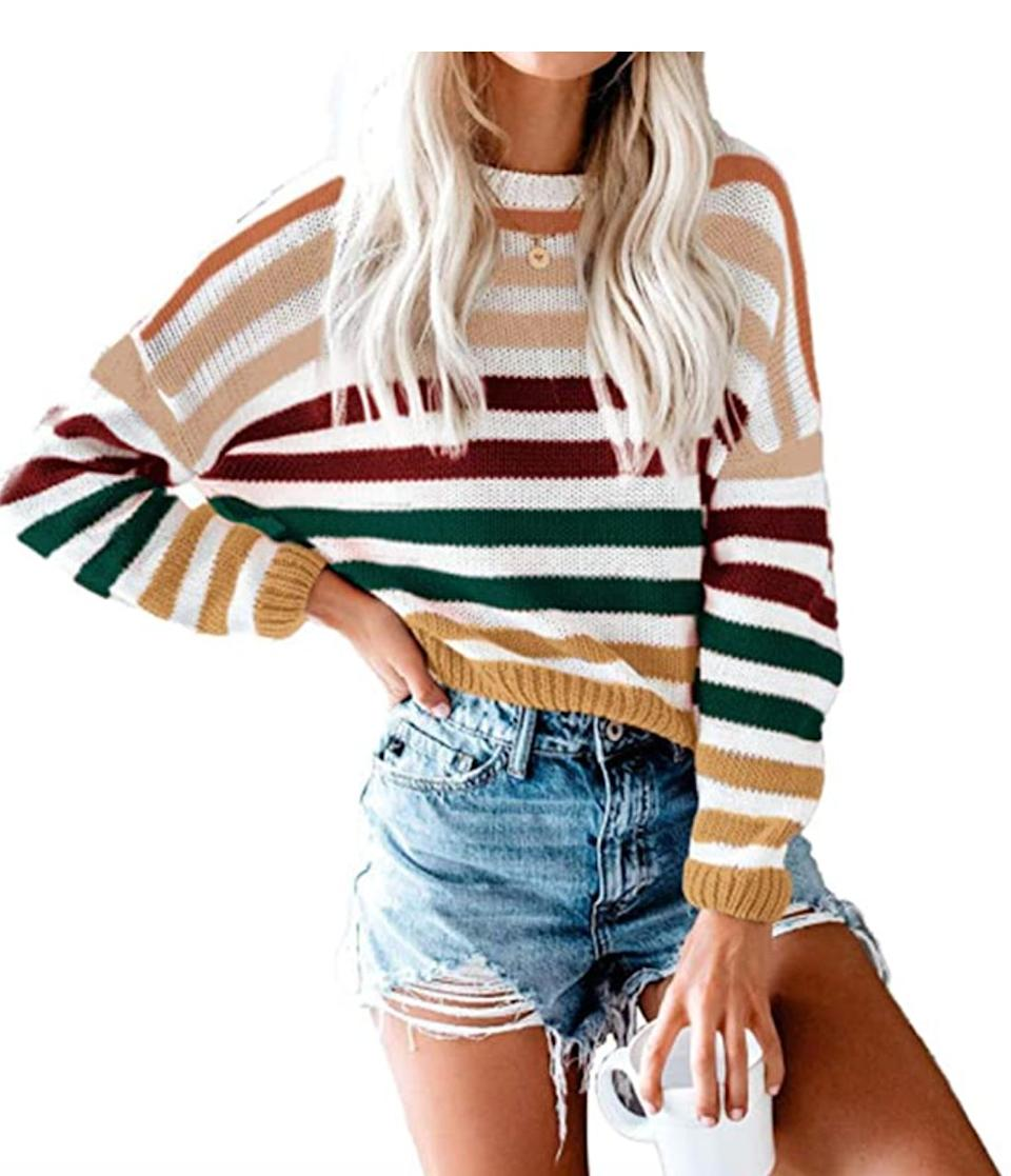 "<a href=""https://amzn.to/361z0Kc"" target=""_blank"" rel=""noopener noreferrer"">This striped crew neck sweater</a> is available in sizes XS to XL in 12 colors. Find it for $31 on <a href=""https://amzn.to/361z0Kc"" target=""_blank"" rel=""noopener noreferrer"">Amazon</a>."