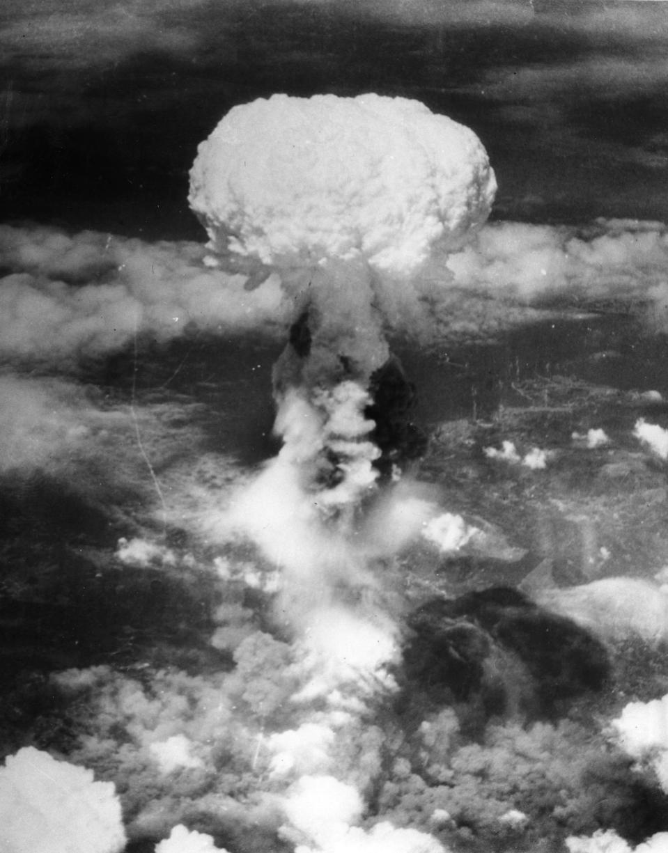 """FILE - In this Aug. 9, 1945, file photo, a giant column of smoke rises more than 60,000 feet into the air, after the second atomic bomb ever used in warfare explodes over the Japanese port town of Nagasaki, dropped by the U.S. Army Air Forces B-29 plane """"Bockscar."""" The city of Nagasaki in southern Japan marks the 75th anniversary of the U.S. atomic bombing of Aug. 9, 1945. Japan surrendered on Aug. 15, ending World War II and its nearly a half-century aggression toward Asian neighbors. Dwindling survivors, whose average age exceeds 83, increasingly worry about passing their lessons on to younger generations. (AP Photo, File)"""