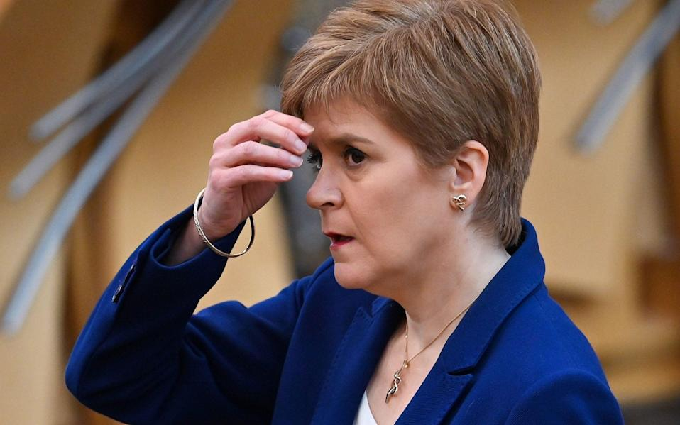 Nicola Sturgeon made the u-turn at Holyrood, leading to confusion for businesses - JEFF J MITCHELL/AFP