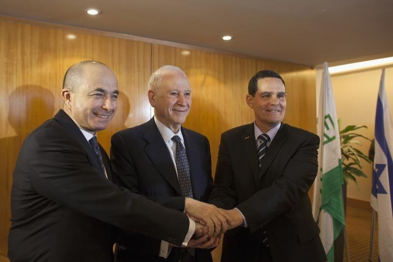 Teva Chairman Frost stands with outgoing CEO Yanai and incoming CEO Levin during a news conference in Tel Aviv