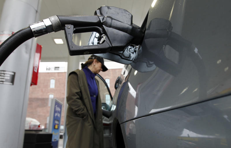 Deborah Delauro waits as she puts gas in her car Friday, Feb. 24, 2012 in Philadelphia. The price of gasoline, which is made from crude oil, has soared as oil prices rise. The national average jumped by nearly 12 cents per gallon in a week, with state averages above $4 per gallon in California, Alaska and Hawaii. (AP Photo/Alex Brandon)