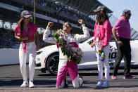 Helio Castroneves, of Brazil, celebrates winning the Indianapolis 500 auto race at Indianapolis Motor Speedway with Adriana Henao, left, and Mikaella Castroneves, Sunday, May 30, 2021, in Indianapolis. (AP Photo/Darron Cummings)