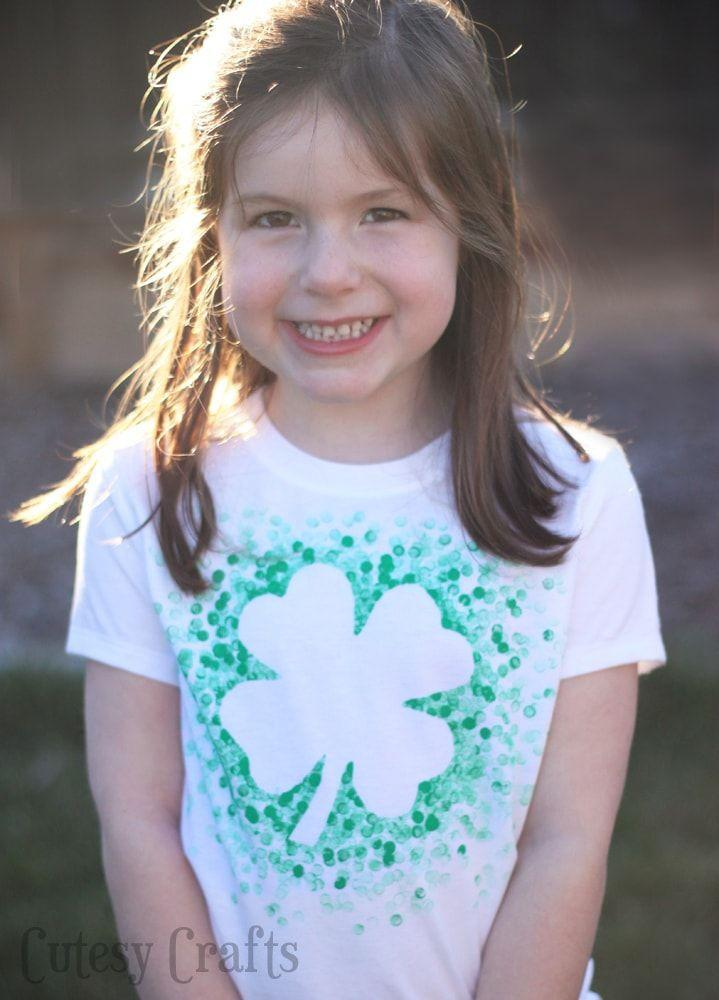 """<p>Instead of buying a new green shirt, have your kids decorate their own St. Paddy's Day shirts to wear to the <a href=""""https://www.womansday.com/life/a4698/5-unique-ways-to-celebrate-st-patricks-day-104555/"""" rel=""""nofollow noopener"""" target=""""_blank"""" data-ylk=""""slk:parade this year"""" class=""""link rapid-noclick-resp"""">parade this year</a>.</p><p><em>Get the tutorial at <a href=""""http://cutesycrafts.com/2014/02/eraser-stamped-st-patricks-day-shirt.html"""" rel=""""nofollow noopener"""" target=""""_blank"""" data-ylk=""""slk:Cutesy Crafts"""" class=""""link rapid-noclick-resp"""">Cutesy Crafts</a>.</em> </p>"""