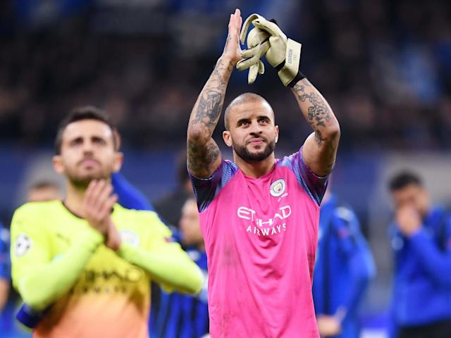 Kyle Walker applauds the Manchester City supporters at full-time: Getty