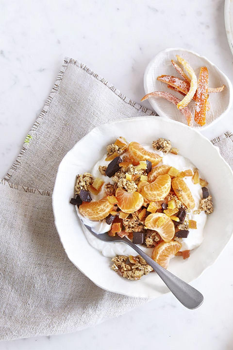 """<p>Surprise mom with this simple but special granola to start her day. Sliced clementines and dark chocolate pieces add to its sweetness!</p><p><strong><a href=""""https://www.countryliving.com/food-drinks/recipes/a41070/candied-orange-peel-granola/"""" rel=""""nofollow noopener"""" target=""""_blank"""" data-ylk=""""slk:Get the recipe"""" class=""""link rapid-noclick-resp"""">Get the recipe</a>.</strong></p><p><a class=""""link rapid-noclick-resp"""" href=""""https://www.amazon.com/Home-table-folding-breakfast-Bamboo/dp/B00PHS97EU/?tag=syn-yahoo-20&ascsubtag=%5Bartid%7C10050.g.1681%5Bsrc%7Cyahoo-us"""" rel=""""nofollow noopener"""" target=""""_blank"""" data-ylk=""""slk:SHOP BREAKFAST TRAYS"""">SHOP BREAKFAST TRAYS</a></p>"""