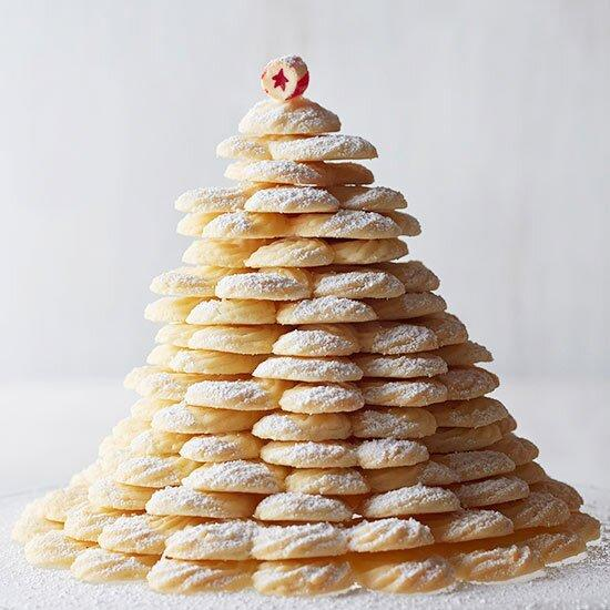 These rich and crisp coconut cookies look stunning stacked into a Christmas tree shape and dusted with powdered sugar!