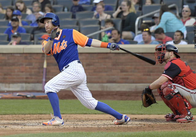 New York Mets' Todd Frazier follows through on a home run as Washington Nationals catcher Matt Wieters, right, looks on during the seventh inning of a baseball game Saturday, Aug. 25, 2018, in New York. (AP Photo/Bill Kostroun)