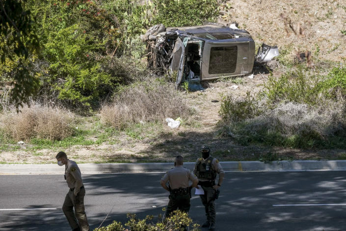 Image: A vehicle rests on its side after a rollover accident involving golfer Tiger Woods along a road in the Rancho Palos Verdes section of Los Angeles on Feb. 23. (Ringo H.W. Chiu / AP)