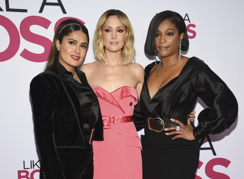 """Actors Salma Hayek, left, Rose Byrne and Tiffany Haddish attend the world premiere of """"Like a Boss"""" at the SVA Theatre on Tuesday, Jan. 7, 2020, in New York. (Photo by Evan Agostini/Invision/AP)"""