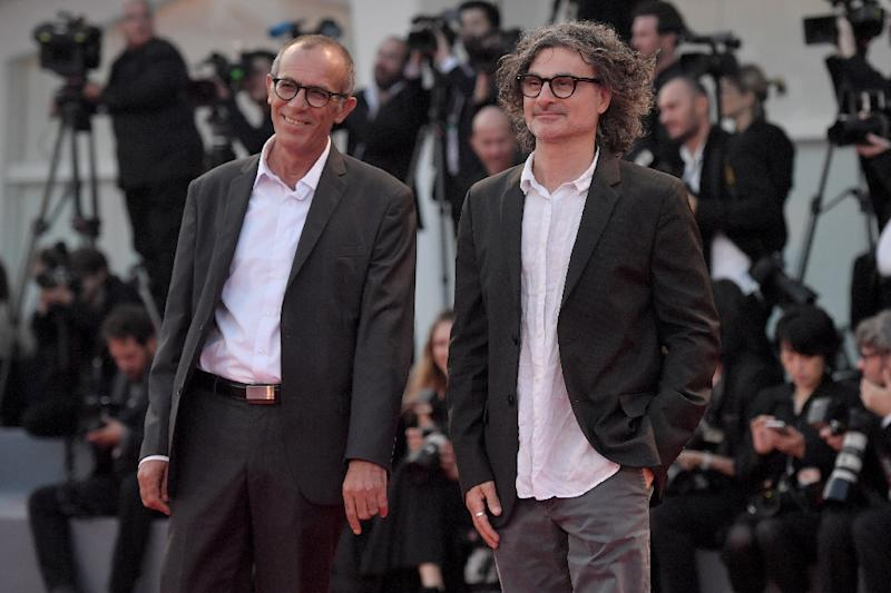 Director Ziad Doueiri and actor Kamel El Basha arrive at the award ceremony of the 74th Venice Film Festival on September 9, 2017 (AFP Photo/Tiziana FABI)