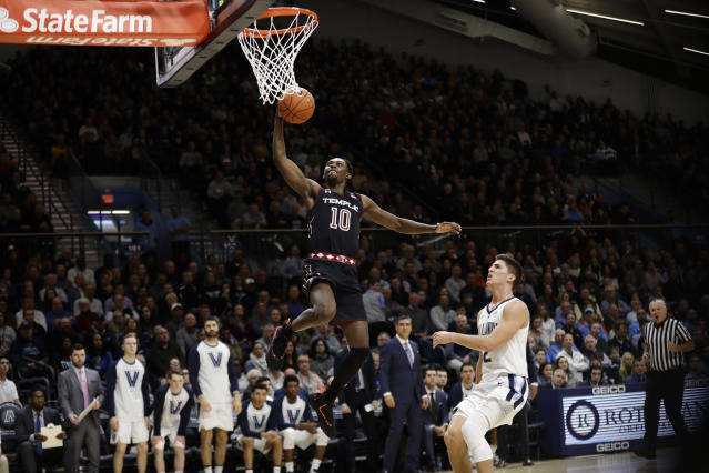 Temple's Shizz Alston Jr. (10) goes up for a shot against Villanova's Collin Gillespie (2) during the first half of an NCAA college basketball game, Wednesday, Dec. 5, 2018, in Villanova, Pa. (AP Photo/Matt Slocum)